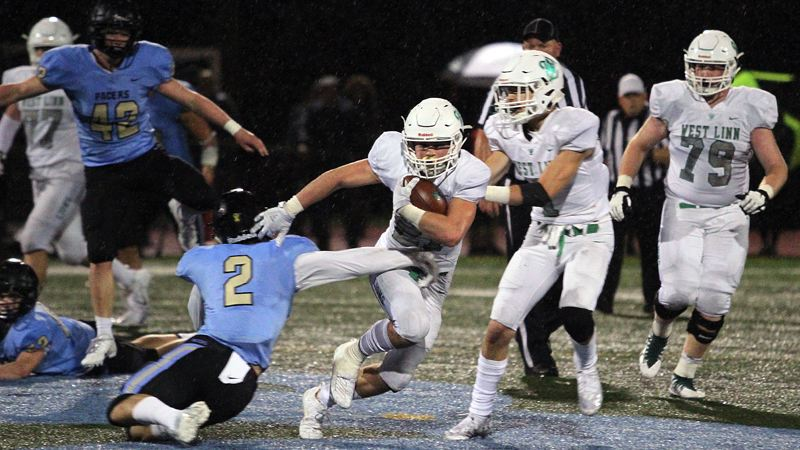 PMG PHOTO: MILES VANCE - West Linn junior running back Gavin Haines rushed for 231 yards and three TDs in his team's 48-27 win over Lakeridhe at Lakeridge High School on Friday, Sept. 27.