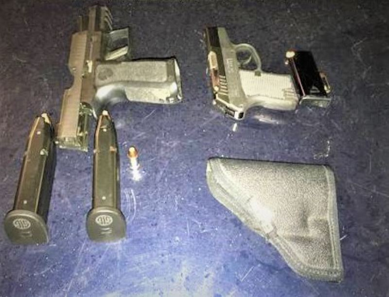 PPB PHOTO - Portland police say they confiscated these two guns from a man in the entertainment district.