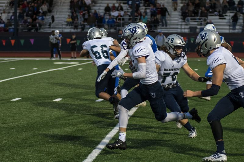 COURTESY PHOTO: GREG ARTMAN - Mason Dean returned the opening kickoff 92 yards for a touchdown Friday in Hillsboro.