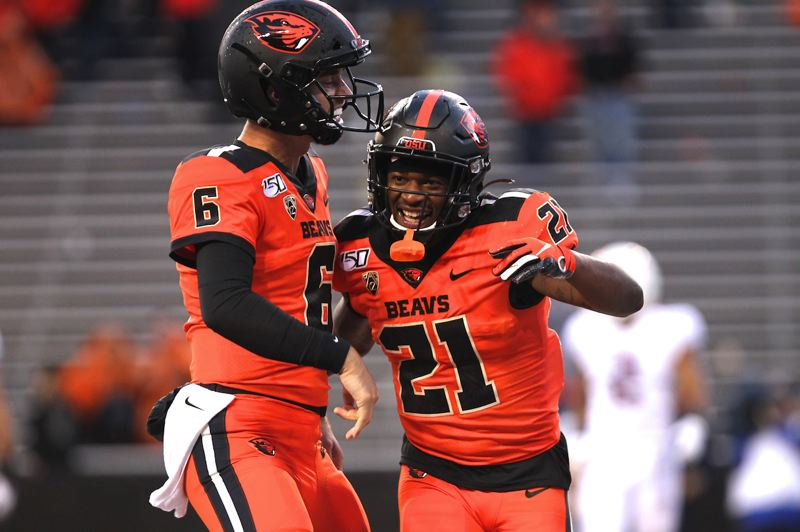 PMG PHOTO: JAIME VALDEZ - Oregon State quarterback Jake Luton (left) congratulates running back Artavis Pierce after scoring against the Stanford Cardinal.