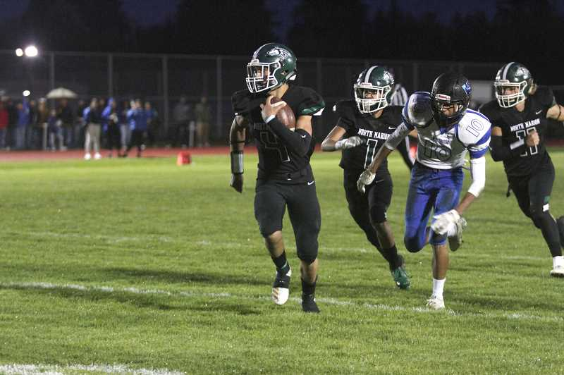 PMG PHOTO: PHIL HAWKINS - Junior cornerback Tanner Saucedo led a defensive charge, picking off a pair of passes and returning one for touchdown for a North Marion team that forced four takeaways and held Woodburn to just 126 yards of offense on the night.