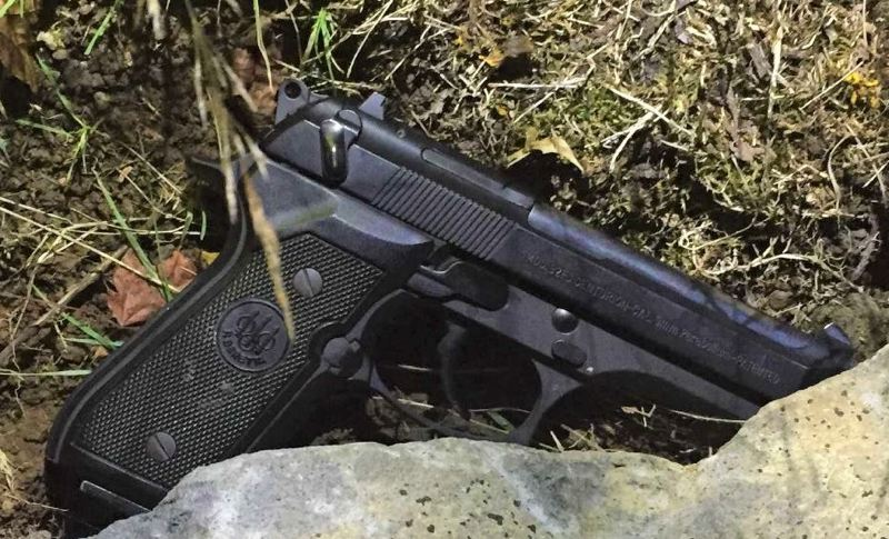 PPB PHOTO - Portland police say they found this allegedly stolen gun hidden behind a rock.