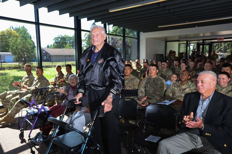 COURTESY PHOTO: NATIONAL GUARD - Bud Lewis stands to be recognized as a WWII 41st Infantry Division member.