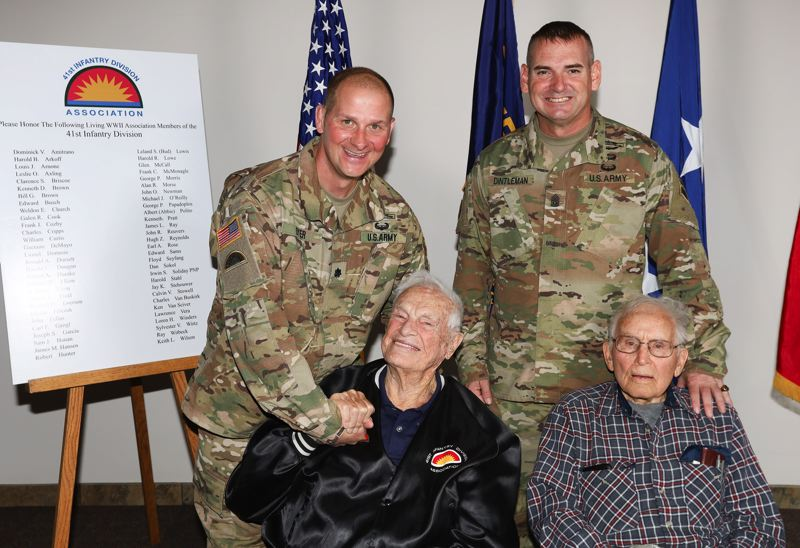 COURTESY PHOTOS: NATIONAL GUARD - Paul Dyer, battalion commander for the 186th Infantry Regiment, and Command Sgt. Maj. Jeff Dintleman visit with WWII 186th members Bud Lewis and Charles Cripps at the street-naming ceremony.