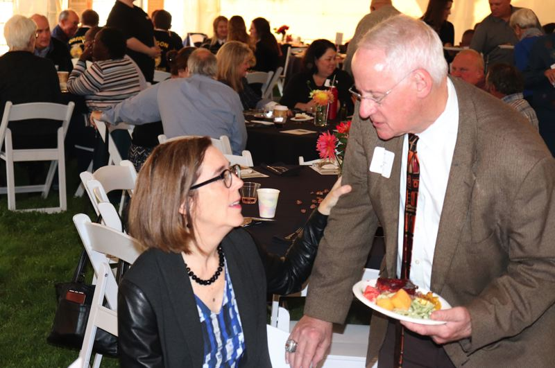 PHOTO COURTESY: KIMBERLY JACOBSEN NELSON - Gov. Kate Brown visits with Oregon State University President Ed Ray at the recent Harvest Dinner.