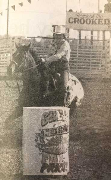 CENTRAL OREGONIAN - SEPTEMBER 29, 1994: Carla Bridges of Powell Butte goes around a barrel Saturday morning during the finals of the Oregon Barrel Racing Association at Crook County Fairgrounds. Her first-place finish in Saturday's $500 novice division go-around gave her the top average for the two-day competition. Another Crook County competitor, Lisa McLean of Paulina, won the $1,500 novice division.