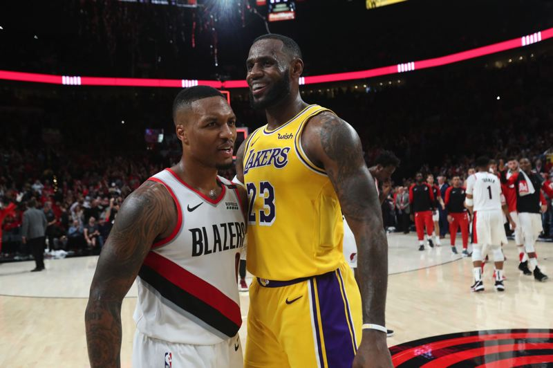PMG FILE PHOTO: JAIME VALDEZ - The Trail Blazers, with Damian Lillard (left) to lead them, and the Los Angeles Lakers, with LeBron James, are strong NBA Western Conference contenders ... but neither is the preseason favorite.