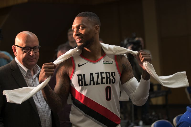 PMG PHOTO: JAIME VALDEZ - NBA All-Star guard Damian Lillard (right) prepares to meet with media on Monday at Memorial Coliseum, flanked Jim Taylor, Trail Blazers senior vice president, communications.