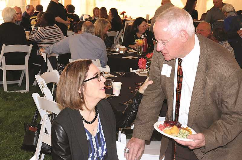 KIMBERLY JACOBSEN NELSON -  Oregon Gov. Kate Brown visits with OSU President Ed Ray at the recent Harvest Dinner in Aurora.