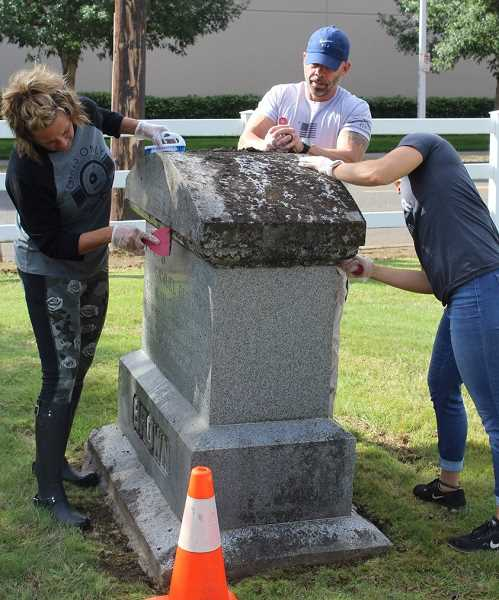 COURTESY PHOTO: HERITAGE & LANDMARK COMMISSION - Sept. 21 was a busy day at the Zion Memorial Cemetery as volunteers spent time cleaning and reconditioning old grave markers at the cemetery. Canby's Heritage Landmark Commission has held four of these gravestone cleaning events thus far, this time cleaning 103 markers in the cemetery.