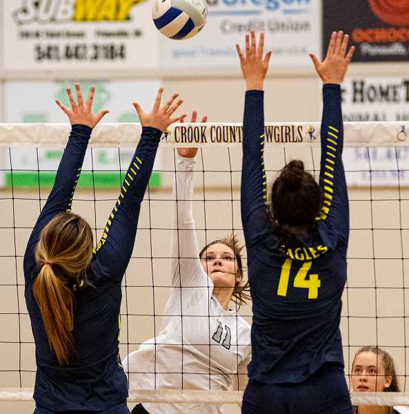 LON AUSTIN/CENTRAL OREGONIAN - Liz Barker blasts the ball for a kill last Tuesday against Hood River Valley while Jenny McKinnon covers. Barker had seven kills against Pendleton on Thursday as the Cowgirls won in straight sets.