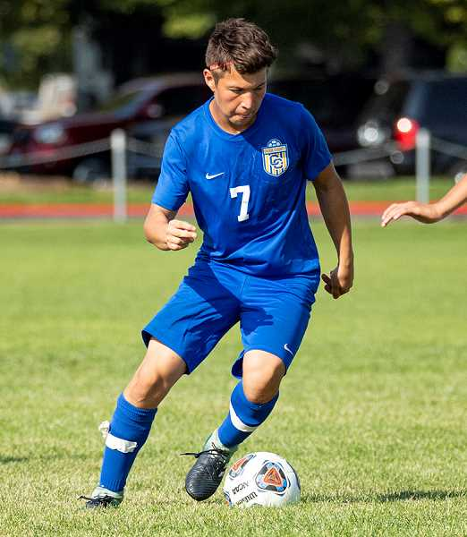 LON AUSTIN/CENTRAL OREGONIAN - Kevin Arroyo plays the ball during a match earlier this year. Arroyo scored one of three Crook County goals on Thursday as the Cowboys lost 5-3 to The Dalles Riverhawks. Elias Villagomez scored the other two Crook County goals.