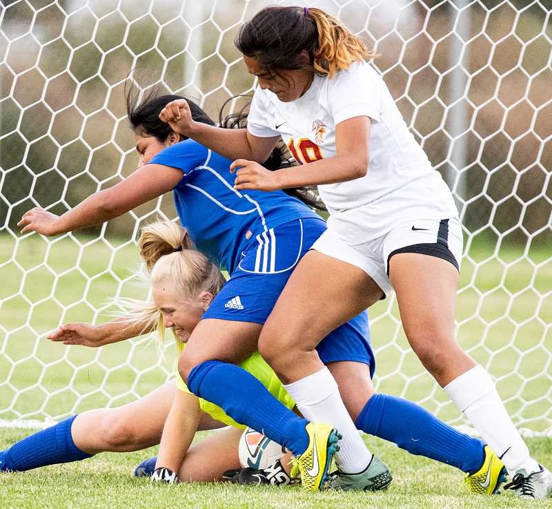 LON AUSTIN/CENTRAL OREGONIAN - Crook County goalkeeper Lakyra Walker makes a save in traffic Thursday afternoon in the Cowgirls' 10-0 loss to The Dalles.