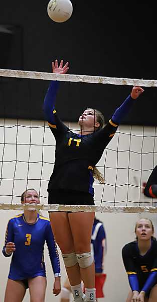 PHOTO COURTESY OF KIM WOODWARD - Kenna Woodward goes up for a tip during the South Albany State Preview Volleyball Tournament. Woodward led the Cowgirls in kills at the event with 32.
