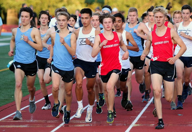 PMG PHOTO: JIM BESEDA - Lakeridge's Mathew Ragsdale and Aidan Strealy (left and second from left) placed fourth and fifth overall to help the Pacers sweep Canby, Oregon City and Lake Oswego at Lakeridge High School on Wednesday, Sept. 25.