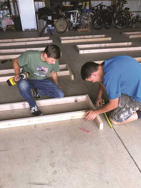 COURTESY PHOTO - Hubbard resident Jordan Williamson (right) did his Eagle Scout community service project for Canby Troop 258 by building four planter boxes for his grandfather's nursing home with the help of his brother and friends. Williamson was joined by Jameson Guido (left), along with his younger brother Joshua and friend Shawn Ostrander in assembling the project.