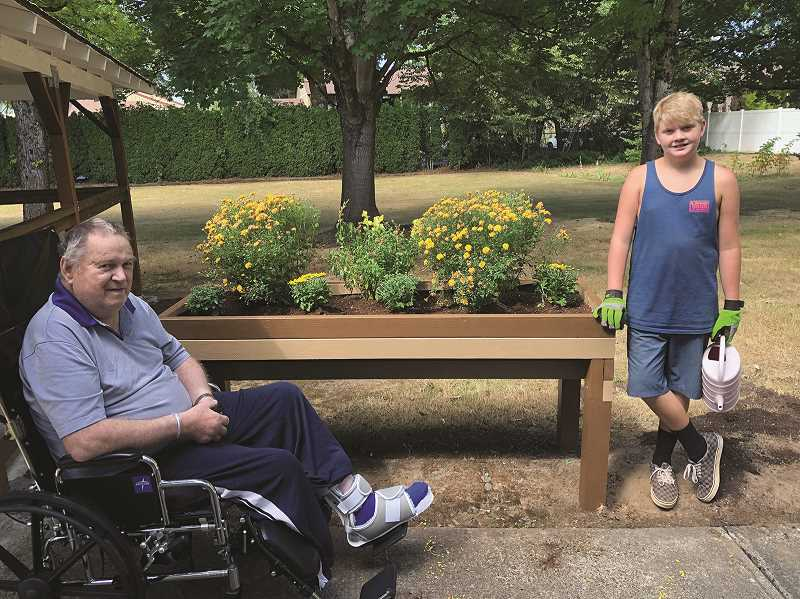 COURTESY PHOTO - Jordan Williamson and grandfather Robert Cotter. While Cotter isn't much of a gardener, his grandsons explained, he still enjoys coming out and taking in the landscaping.