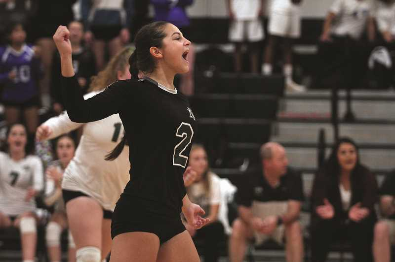 PMG PHOTO: PHIL HAWKINS - North Marion sophomore Megan Netter celebrates a point in the Huskies 3-0 win over Madras on Sept. 25. The No. 10 Huskies are 10-2 on the season after sweeping their first two league games last week.