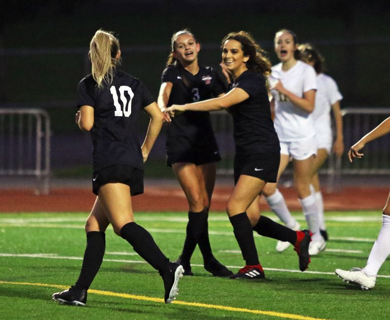 PMG PHOTO: DAN BROOD - Sherwood's (from left) Ellie Schmidt, Ella Weathers and Allison Alvarado celebrate following Alvarado's goal in the Bowmen's 3-1 victory over Cleveland.