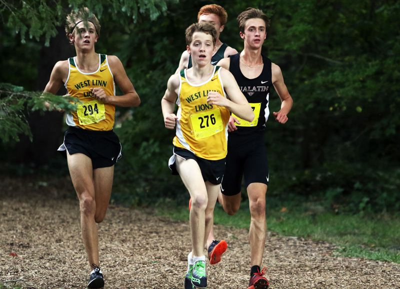 PMG PHOTO: DAN BROOD - West Linn's Dash Lipsey (center) and Cole Rogers placed first and fourth overall in their team's meet against Tigard and Tualatin at Mary S. Young State Recreation Area on Wednesday, Sept. 25.