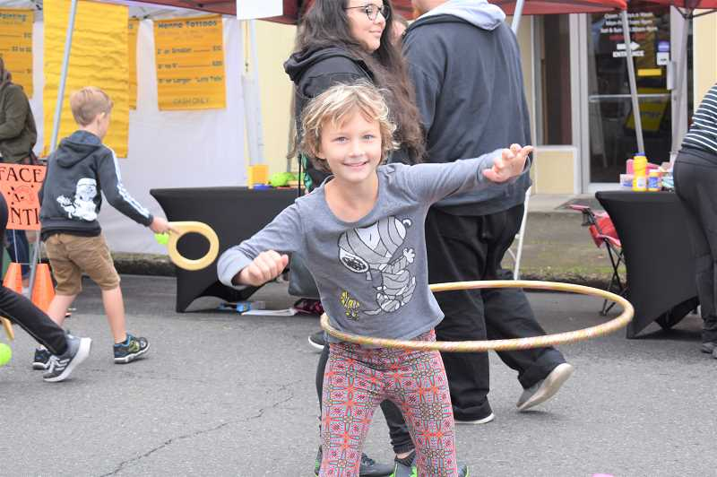 PMG PHOTO: EMILY LINDSTRAND - A young Harvest Festival attendee plays with a hula hoop.