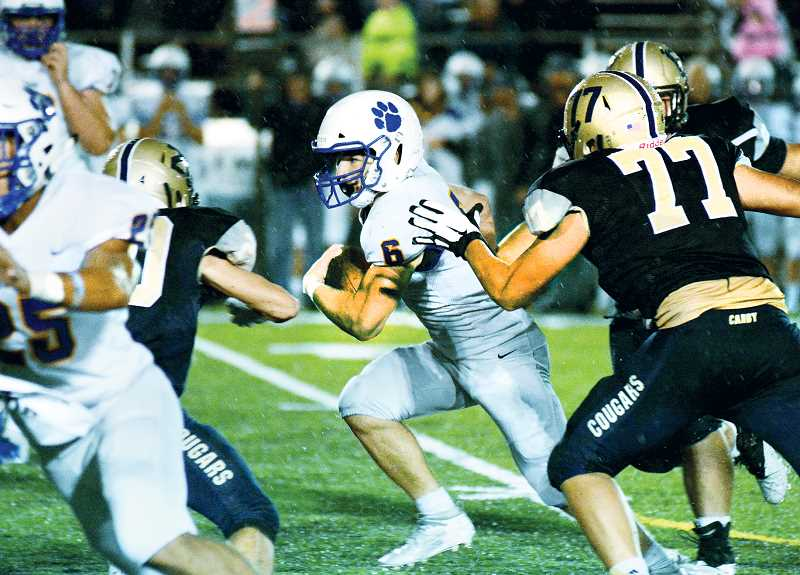 CANBY HERALD PHOTO: DEREK WILEY - Senior running back Justin Holtan is part of a three-headed monster in the Newberg backfield that ran for 385 yards against Canby.
