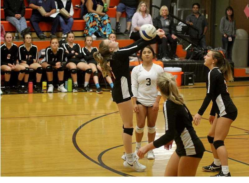 STEELE HAUGEN - Emma Richards returns the ball backwards during Culver's 3-0 win over Chemawa Sept. 27.