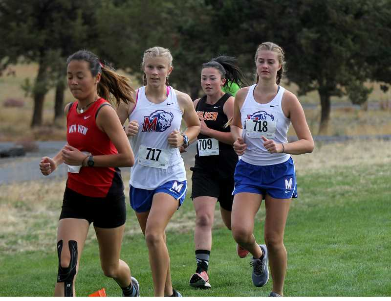 STEELE HAUGEN - Left to right, Madras freshman Hannah MacDuffee (23:59.57), Kiana Webb (27:12.95), of Culver, and Eryn McCourtney (26:29.71), of Madras, all finish in the top 20 racers at a cross country meet at Juniper Hills in Madras Sept. 28.