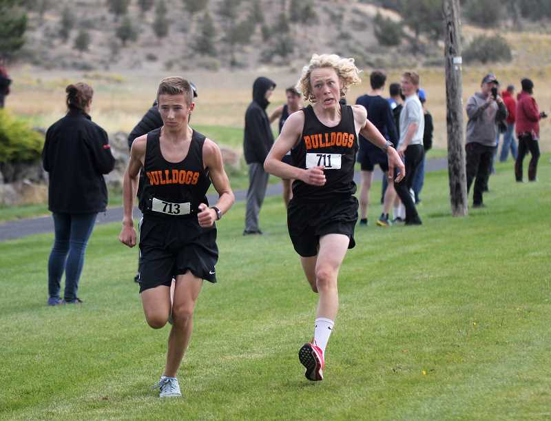 STEELE HAUGEN - Culver's Evan Powell and Jake Horat run hard at the finish line.