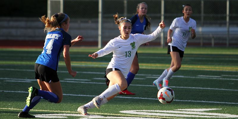 PMG PHOTO: MILES VANCE - West Linn sophomore defender Asia Hardin (right) races upfield with the ball during her team's 1-0 win over Grant at the Grant Bowl on Thursday, Sept. 26.