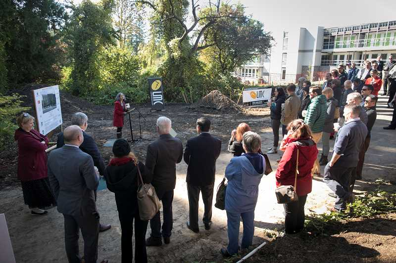PMG PHOTO: JAIME VALDEZ - Elected and state officials along with community members listen to Rachael Duke, director of Community Partners for Affordable Housing, during ground-breaking ceremonies for Red Rock Creek Commons Tuesday.