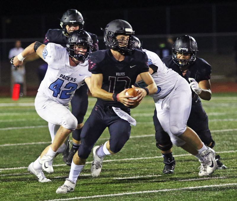 PMG PHOTO: DAN BROOD - Tualatin High School senior quarterback Blake Jackson, shown here in a game earlier this season, had 253 yards of total offense, and three total touchdowns, in the win over Sunset.