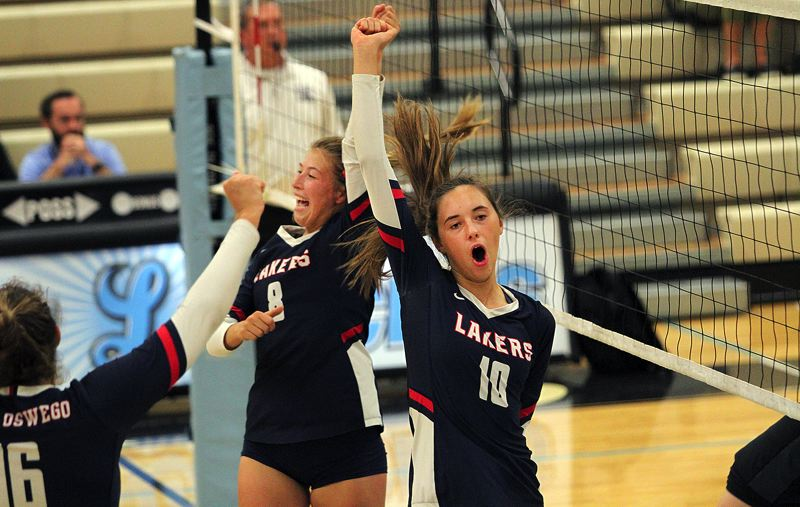 PMG PHOTO: MILES VANCE - Lake Oswego's Morghn Monahan (No. 10) and Jensen Kaelin celebrate a point in their team's 3-1 win over Lakeridge at Lakeridge High School on Thursday, Sept. 26.