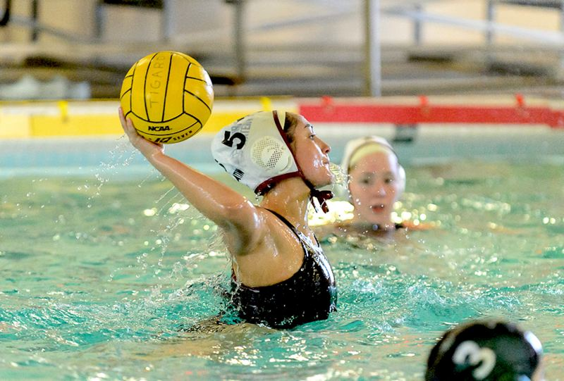 COURTESY PHOTO: CHRIS GERMANO - Tualatin High School senior Halle Mitchell looks to take a shot during the Timberwolves' 10-6 win over rival Tigard on Monday.