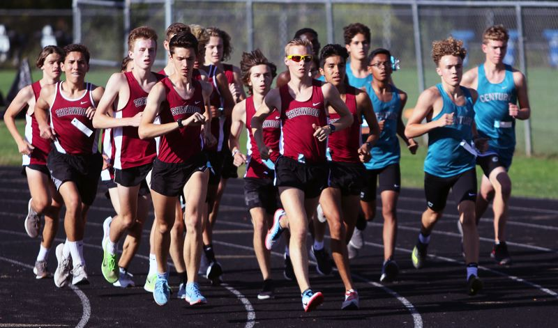 PMG PHOTO: DAN BROOD - The Sherwood High School boys cross country team, shown here in a meet earlier this season, beat both McMinnville and Liberty to improve to 3-0 in Pacific Conference meets.