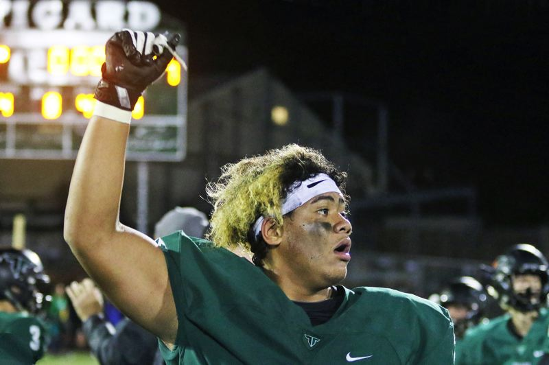PMG PHOTO: DAN BROOD - Tigard High School senior lineman Johnny Nomani celebrates following the Tigers' 31-7 win over Lake Oswego in Special District 5 action at Tigard High School on Friday, Sept. 27.