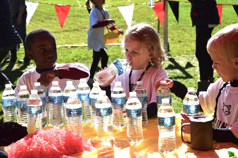 COURTESY PHOTO: ALANA KENT - Students stay hydrated while running laps for River Grove.