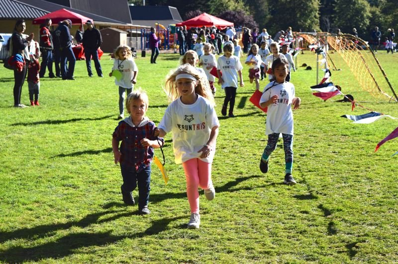 COURTESY PHOTO: ALANA KENT - Students of all ages participated in the River Grove Raccoon Run Tuesday.