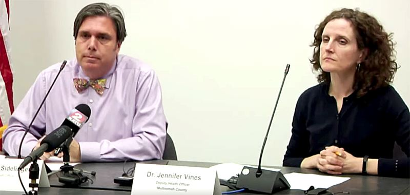 COURTESY PHOTO - Dr. Dean Sidelinger, Oregon health officer, left, and Dr. Jennifer Vines, discuss the state's response to vaping deaths during a Sept. 26 press conference.