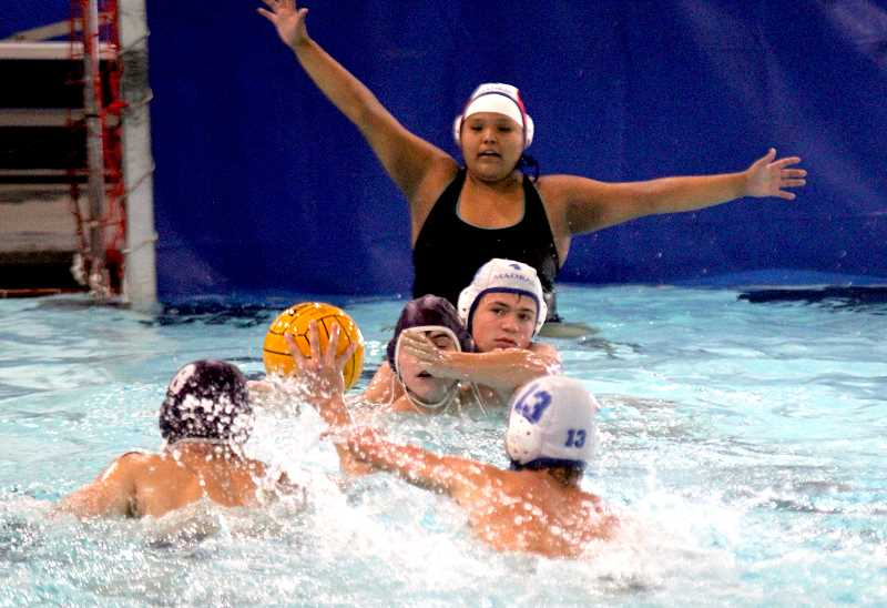 STEELE HAUGEN - Lane Downing defends a Ridgeview water polo athlete during the Buffs' 8-8 tie to the Ravens.