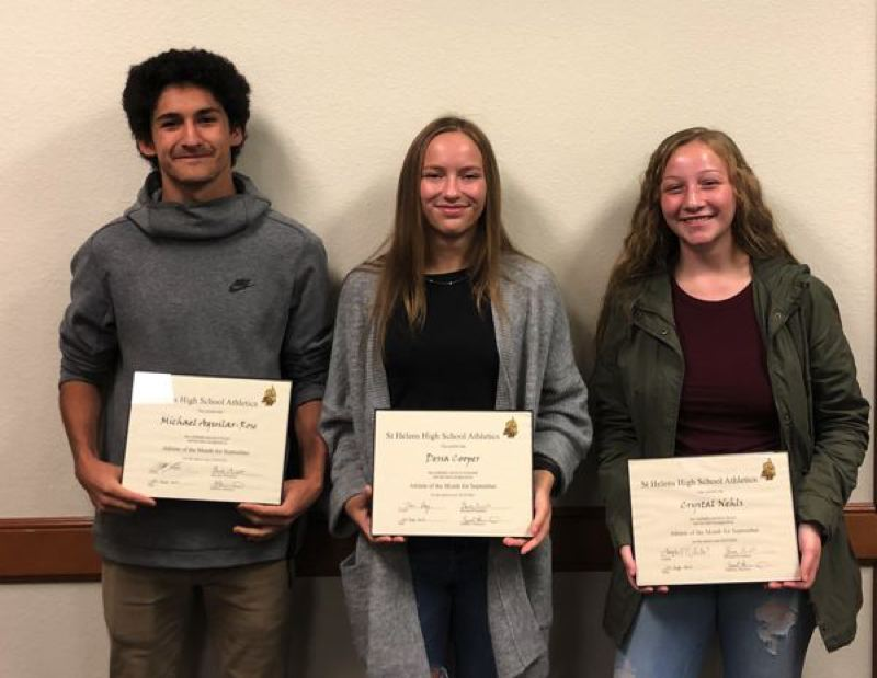 COURTESY PHOTO: ST. HELENS SPORTS BOOSTER CLUB - Athletes for the month of January, as recognized by the St. Helens Sports Booster Club, are (from left) Michael Aguilar-Rose, boys soccer; Dessa Cooper, volleyball; Crystal Nehls, girls soccer; and (not pictured), Jayden Smith, football.