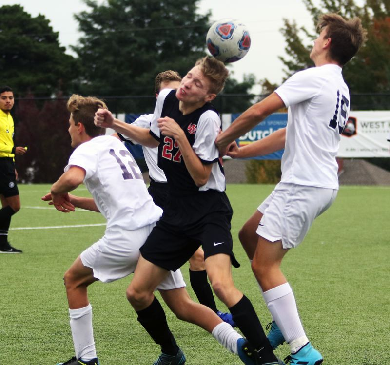 PMG PHOTO: DAN BROOD - Westside Christian senior Joseph Fruehauf (27) gets his head on the ball during the Eagles' match with Portland Adventist Academy on Oct. 2.