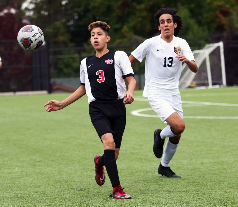 PMG PHOTO: DAN BROOD - Westside Christian freshman Josh Palacios (left) looks to take control of the ball during the Eagles' match with Portland Adventist Academy on Oct. 2.