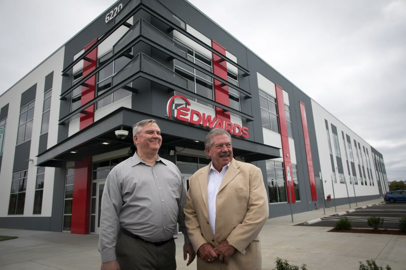 PAMPLIN MEDIA GROUP: JAIME VALDEZ - Mark Prusiecki (left) general manager, Hillsboro Product Company, Edwards Vacuum LLC, and Scott Balaguer, vice president and general manager of Edwards Semiconductor division North America, in front of Edwards new American headquarters at 6220 N.E. Century Boulevard, Hillsboro. As well as offices, sales and training, the building receives parts from around the world which are then assembled and shipped off to big chipmakers.