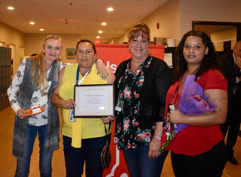 PMG PHOTO: TERESA CARSON - Julie Mahn, a prospective Skills2Work student, Mary Coffey a recent graduate of the program, and Human Solutions coaches Shawna Hoffman and Jennifer Bonnette celebrate Coffey's accomplishment.