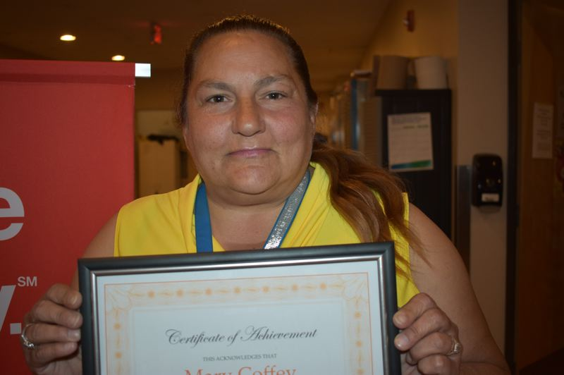 PMG PHOTO: TERESA CARSON - Mary Coffey shows off her graduation certificate and said she was thankful for all the help the Human Solutions program provided.