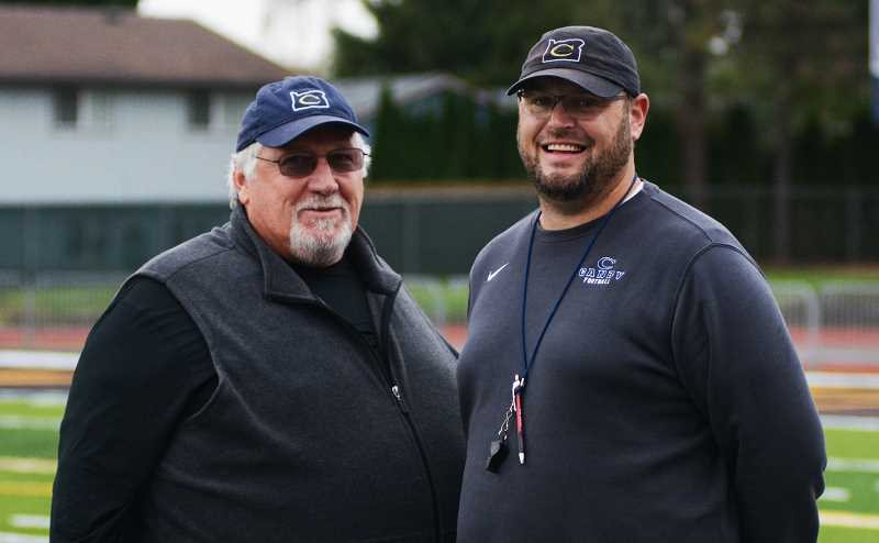 PMG PHOTO: DEREK WILEY - Canby quarterbacks coach Faustin Riley, left, and head coach Jimmy Joyce won a state title together at Beaverton in 1999.