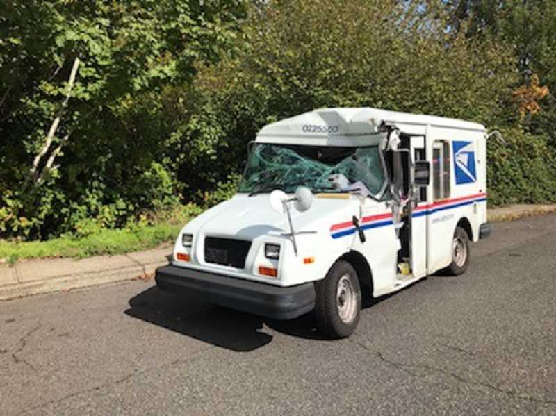 COURTESY PHOTO: PORTLAND POLICE BUREAU - The damaged mail truck was recovered after a woman stole it Thursday afternoon, Oct. 3