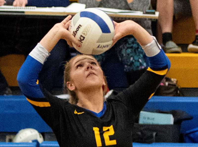 LON AUSTIN/CENTRAL OREGONIAN - Anna Woodward finished with 36 assists and 10 digs Tuesday night in the Cowgirls' match with the Ridgeview Ravens. Ridgeview won in four sets to take sole possession of first place in the IMC.