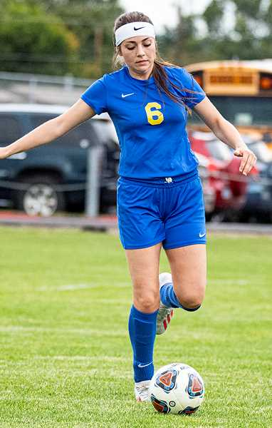 LON AUSTIN/CENTRAL OREGONIAN - Crook County forward Lauren Papke plays a ball during a match earlier this year. Papke and the Cowgirls fell 10-0 to the Hood River Valley Eagles Tuesday afternoon in Hood River.
